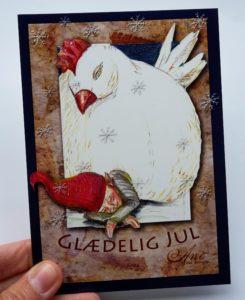 julekort med nisse under høne